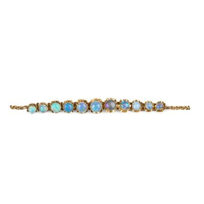 Art Deco Yellow Gold fine Opal Cabochon bracelet with multi-hinged floral setting adorned with vibrant Opals c1920.